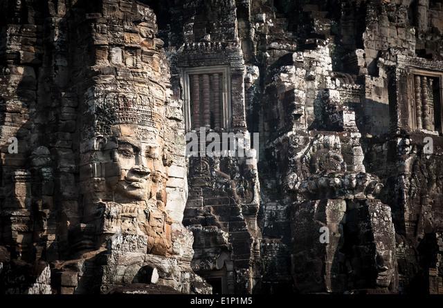 Stone buddha head wat cambodia stock photos stone buddha for Wat architecture