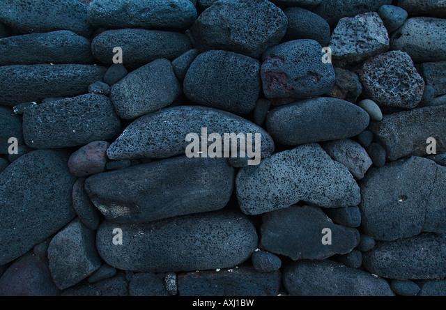 Rock wall hawaii stock photos rock wall hawaii stock for Lava rock pavers