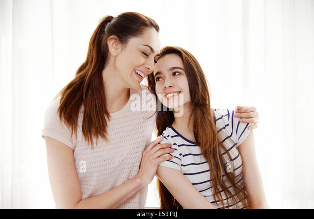 Mother and daughter hugging - Stock Image