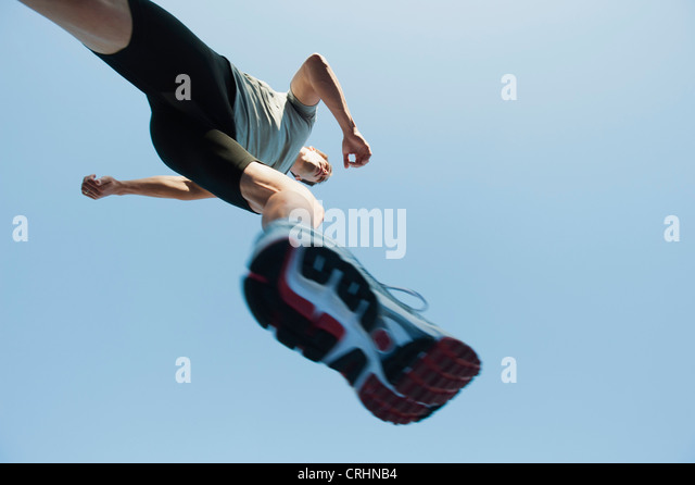 Runner in mid-stride, viewed from directly below - Stock Image