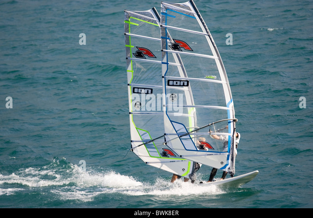 windsurfing wind surfing surfing surfer Lake Garda Lago di Garda lake Lake Garda Italy Europe Trento Trenti - Stock Image