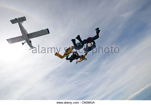 Formation skydiving over Saanen, Bern, Switzerland - Stock Image