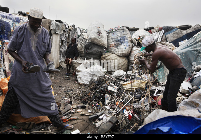 People living as scavenger sort out waste at the Olusosum dump site in Lagos, Nigeria. - Stock Image