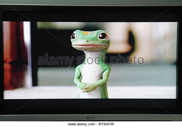 Miami Beach Florida television TV flat panel screen monitor cable channel GEICO gecko advertisement advertise sell - Stock Image