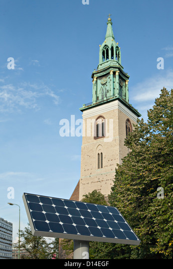 solar panel in front of church - Stock Image