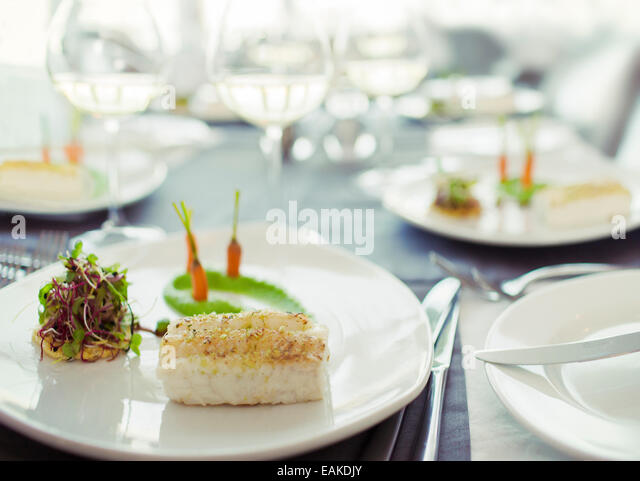 Close up of fancy fish meal on table - Stock Image