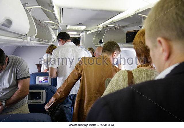 Atlanta Georgia Hartsfield-Jackson Atlanta International Airport Delta Airlines man men woman overhead compartment - Stock Image