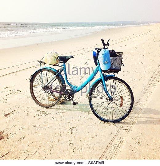 Bicycle on the beach, Goa, India - Stock Image