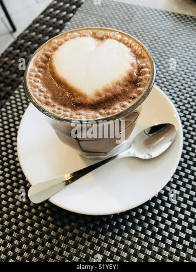 A cafe mocha coffee with a heart drawn in the foam. - Stock Image