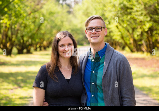 Lifestyle portrait of a happy couple outdoors with natural light. - Stock-Bilder