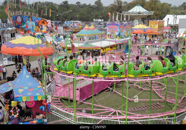 Florida Plant City Florida Strawberry Festival annual event carnival midway rides food roller coaster - Stock Image