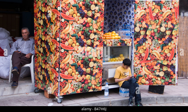 Turkey Istanbul Young boy at fruit stall - Stock Image