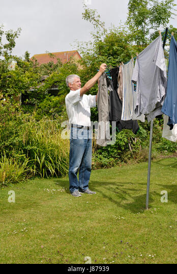 Clothes Being Washed ~ Clothes dryer garden stock photos