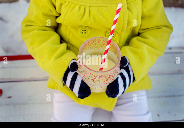 Close-up of a girl holding a drink - Stock-Bilder