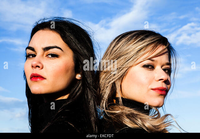 Portrait of two young women looking serious - Stock Image