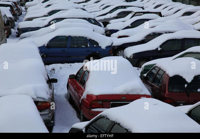 parking lot with cars covered by snow in winter. Photo by Willy Matheisl - Stock Image