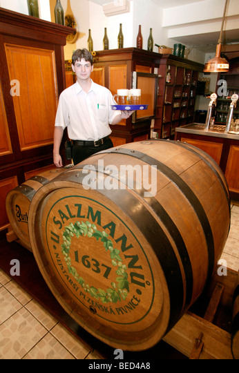 Servant at the entrance of the famous tavern and bierkeller U Sulzmannu, from where the fame of the famous Pilsner - Stock Image