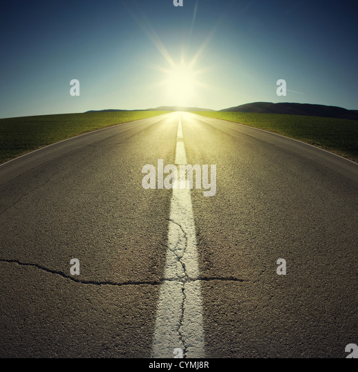 asphalt of country road in backlight - Stock-Bilder
