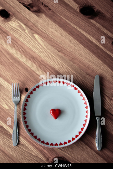 heart,hungry,place setting - Stock Image
