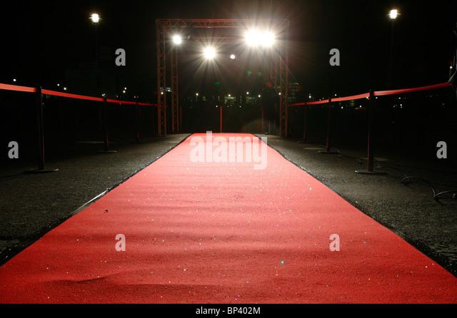 Red carpet in floodlight - Stock-Bilder