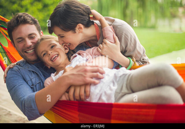 Family having fun together at home on the weekend - Stock Image
