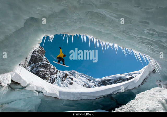Snowboarding in the ice cave, Val Roseg, Pontresina, Canton of Graubünden, Switzerland - Stock-Bilder