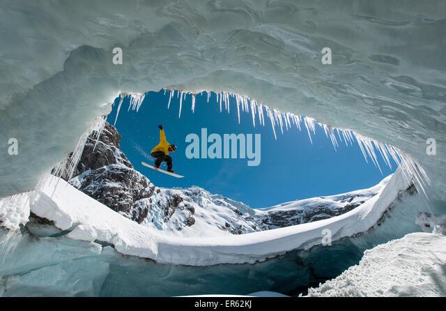 Snowboarding in the ice cave, Val Roseg, Pontresina, Canton of Graubünden, Switzerland - Stock-Bilder