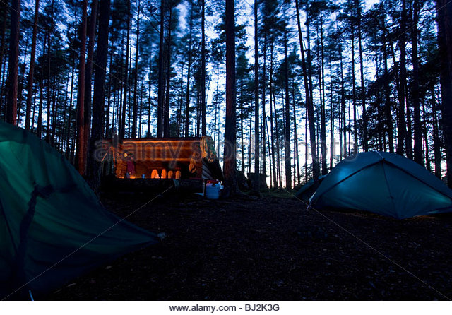 Night in a Vindskydd shelter during a canoe trip with kayaks and canoes on the Stora Gla in the nature reserve Glaskogen - Stock Image