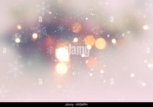 Decorative Christmas background with snow and bokeh lights - Stock Image