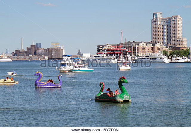 Maryland Baltimore Inner Harbor skyline Patapsco River port waterfront Harborplace attraction paddle boat ride dragon - Stock Image