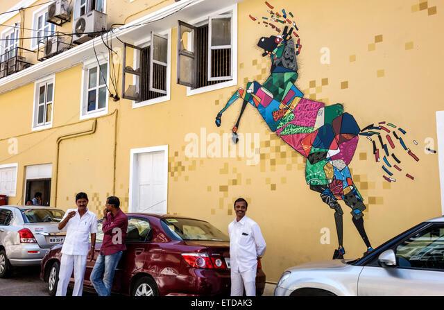 Mumbai India Indian Asian Fort Mumbai Kala Ghoda wall mural art horse figure man - Stock Image