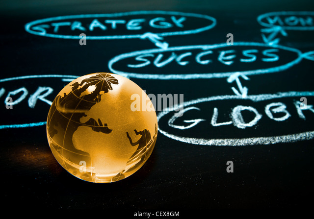 Flowchart on a chalk board with world globe showing Africa - Stock Image