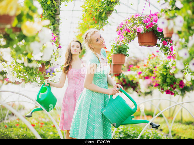 Two rustic ladies in the green house - Stock Image