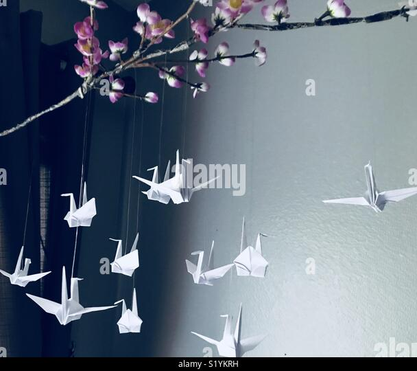 Create a mobile using origami paper folding. - Stock Image