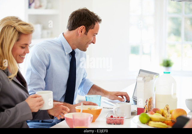 Couple Having Breakfast Together Before Leaving For Work - Stock-Bilder