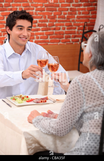 Woman and grandson at the restaurant - Stock Image