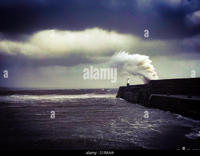 Waves hitting the harbour at Porthcawl, South Wales - Stock Image