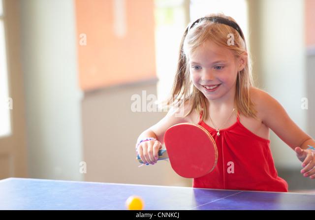 Girl playing table tennis - Stock Image