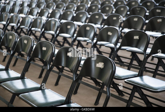 Amphitheater chairs lined up - Stock Image