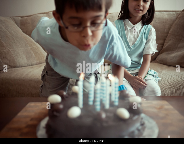 Blowing out birthday candles - Stock-Bilder