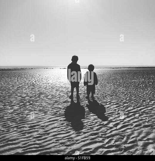 Boys at the beach, St Bees, Cumbria, England - Stock-Bilder