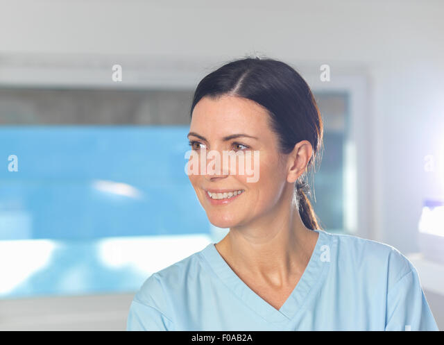 Health worker at work, window in background. - Stock Image