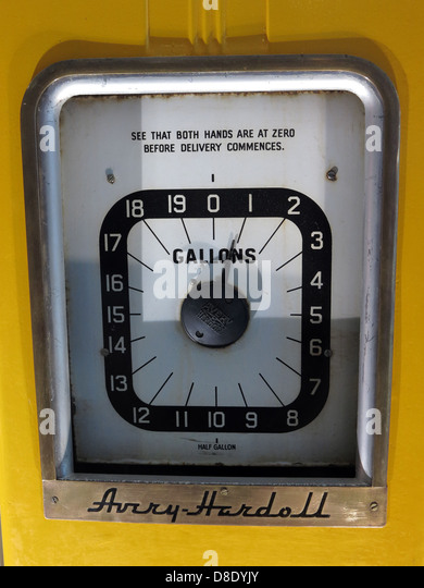 Yellow Avery Hardell petrol pump gas gallons station - Stock Image