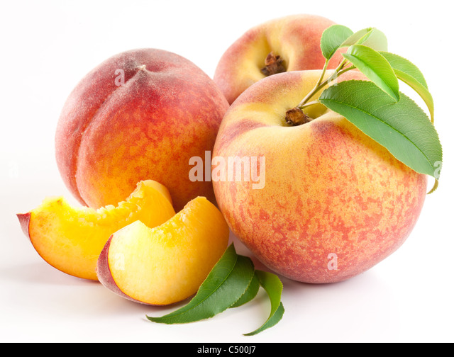 Ripe peach fruit with leaves and slices on white background. - Stock Image