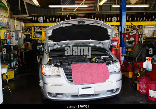Minivan in a Service Station - Stock Image