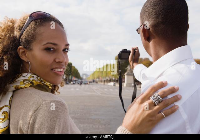 African couple taking photograph - Stock-Bilder