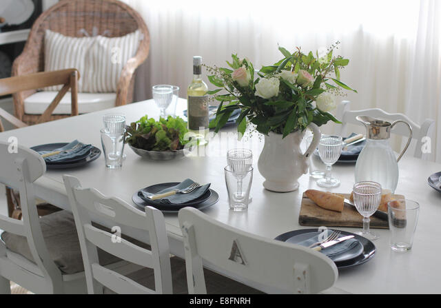 Dining table set for lunch with crockery - Stock Image