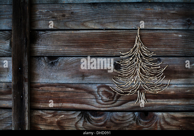 christmas tree on wooden background, new year card - Stock Image