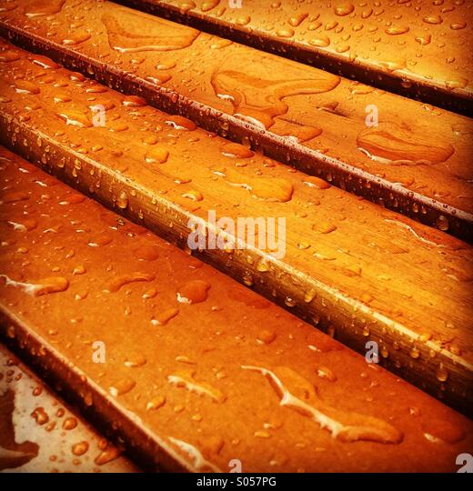 Rain on varnished wood - Stock Image