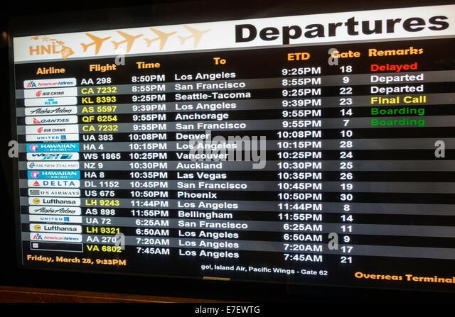 Hawaii Hawaiian Oahu Honolulu Honolulu International Airport HNL terminal concourse gate area departures schedule - Stock Image